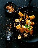 Fried tofu cubes with sesame