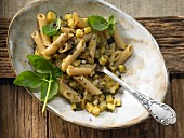 Penne with zucchini and capers in an orange and basil sauce