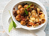 Orecchiette with lamb meatballs, eggplant and raisins