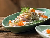 Pasta in a creamy dill sauce with smoked trout and caviar