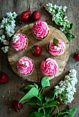 Pink buttercream cupcakes with strawberries