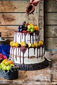 Two-tiered naked cake with vanilla buttercream and fruits