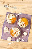 Yogurt and apricot jam dessert with meringues