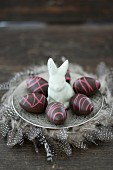 Chocolate easter eggs and a porcelain rabbit