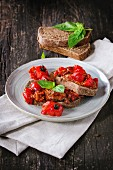 Italian tomato bruschetta with baked cherry tomatoes and fresh basil