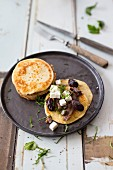 Blinis with feta and olives