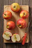 Fresh Rubinette apples on a chopping board