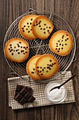 Tuiles with chocolate chips on a cake rack