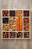Various dried fruit and nuts in a case