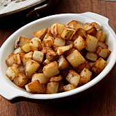 Cubed fried potatoes in bowl