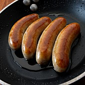 English bangers (breakfast sausages) in skillet