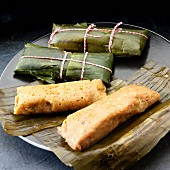 Pastele de Masa, pork pasteles. shredded pork and vegetables in banana leaf