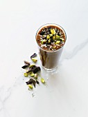 Dark chocolate smoothie with hemp seeds, pistachios, cacao nibs, dark chocolate