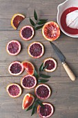 Blood orange slices with a citrus press