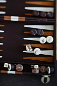 Various chocolates on a backgammon board