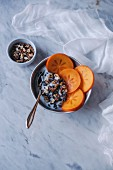 Yogurt with persimmon, walnuts and cacao nibs