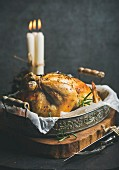Oven roasted whole chicken with oranges, bulgur, rosemary and decorative candles