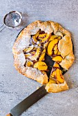 A galette with nectarines, figs and powdered sugar