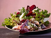 A salad with Nashi pear, pomegranate seeds, feta and beetroot