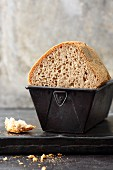 Gluten-free rye and wheat bread in a baking tin