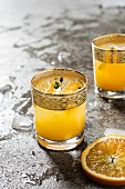 Cocktail with orange juice on grey background