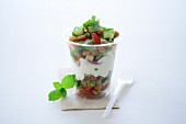 Garden salad with croutons and a yoghurt dressing in a takeaway cup