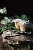 Baskets of ricotta cheese on table