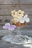 Folded paper butterflies on glass sweet jar of biscuits