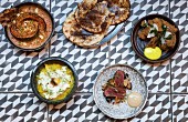 Various curry dishes with flatbread (India)