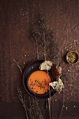 Sweet potato soup with coconut milk and pumpkin seeds
