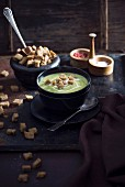 Vegan avocado soup with croutons