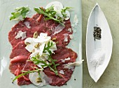 Beef carpaccio with mushrooms, rocket and Parmesan