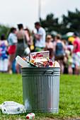 Overflowing rubbish bin, UK
