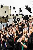 Students tossing mortar boards