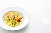 Norwegian cod spring roll on a bed of fennel and saffron-curry espuma