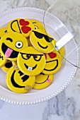 Cookies decorated with different smiley faces
