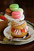 Cream puff pastry and Macarons on a table