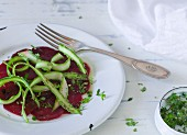 Beetroot carpaccio with green asparagus