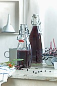 Homemade elderberry juice in bottles