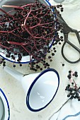 Ingredients and kitchen utensils for making homemade elderberry juice