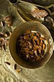 Beech seeds (Fagus sylvatica) in a metal bowl