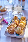 Spicy mini profiteroles filled with shrimps and sprouts