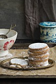 Barley flour biscuits with icing sugar, stacked