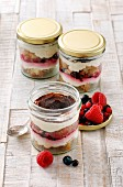Tiramisu with forest fruits in glass jars