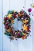 A Christmas wreath with biscuits and berries