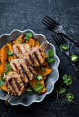 Grilled pork kebabs with sweet potatoes, coriander green and jalapeno
