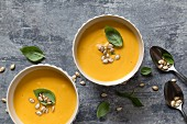 Pumpkin soup with roasted pumpkin seeds and basil