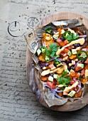 Sweet potato chips with a vegetable salad