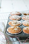 Almond muffins in a muffin tin