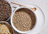 Sorghum, linseed and lentils in bowls